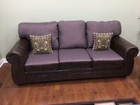 brown fabric 3-seat sofa with throw pillows 557 km