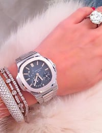 round silver-colored chronograph watch with link bracelet Toronto, M2K 0B7