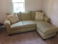 Light green small sectional sofa with throw pillows Tampa, 33611