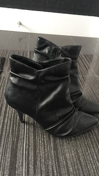 f71087984fc7 Used pair of black leather side-zip biker booties for sale in Les ...
