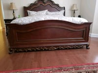 brown wooden bed frame with mattress Markham, L3P 2A7