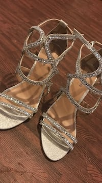 Pair of silver-colored open toe ankle strap heels Edmonton, T6W 1Y9