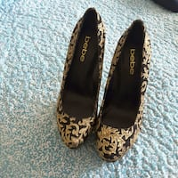 pair of brown and black Coach flats Westchase, 33626