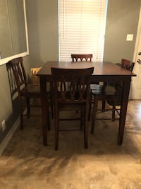 Square brown wooden table with four chairs Hurst
