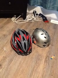 black and red bicycle helmet with gray skateboard helmet Langley, V2Y 0J5