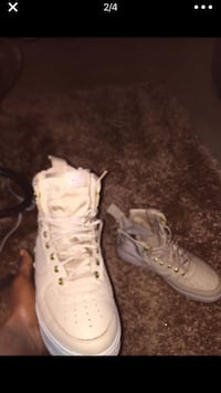 pair of white leather high-top sneakers 685 mi
