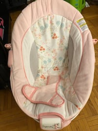 baby's white and pink Ingenuity floral bouncer