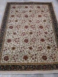 brown and white floral area rug Jackson