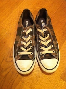 Brown and black all star converse low top sneakers