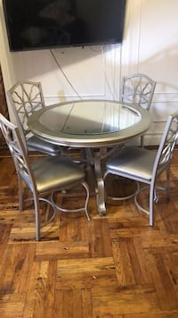 round white wooden table with four chairs dining set New York, 10472