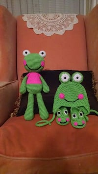 green and pink knitted plush toy null