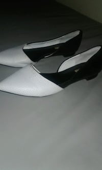 white-and-black pointed-toe flats