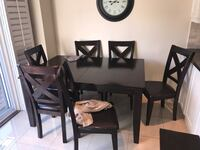 Kitchen table with 6 chairs. Solid. Great condition. First good offer takes it.