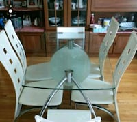 Glass top dining table. It's in good condition. Mississauga