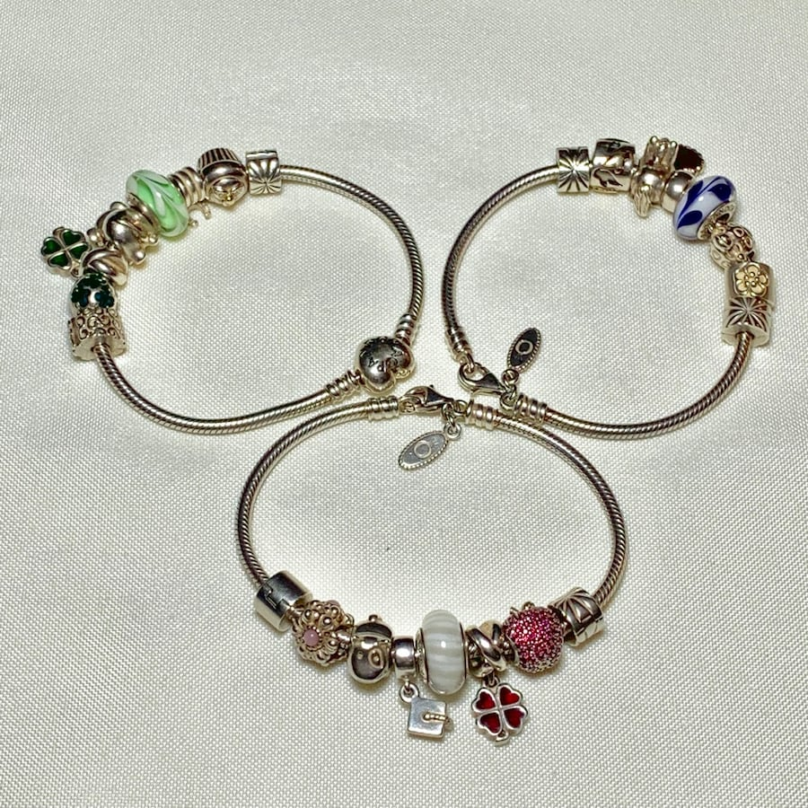 Authentic Pandora Sterling Silver Charm Bracelets with Retired Charms b5ebf9a7-cf1c-40b0-9cf3-3d4c736ef030
