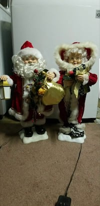 two Santa Claus and Mrs Claus figurines