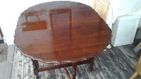 Drop leaf table with carved and scalloped edges. Gate leg CHATHAM