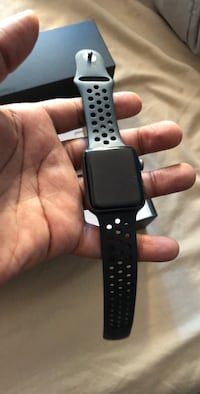 black Apple Watch with black sports band