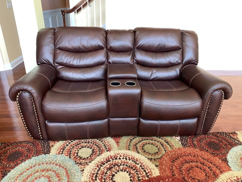 3 seater leather sofa & love seat with console. 1
