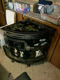 Chinese black lacquer corner cabinet