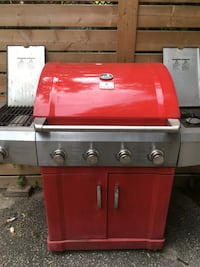 red and gray gas grill