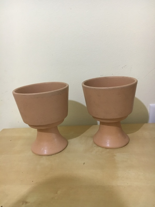 two brown wooden candle holders d9e1920d-2269-48cc-93a4-ddba2b1ecf5d