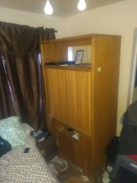 brown wooden TV hutch with flat screen television Bakersfield, 93308