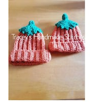 two pink-and-blue strawberry knit caps
