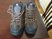 green-and-black Columbia hiking boots 34 km