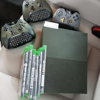 black Xbox 360 console with controllers and game cases New York, 10035
