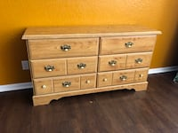 """Large faux wood dresser cabinet. Has 6 large drawers drawers and all of them work perfectly. Measures 70x16"""" by 34"""" in height. Price is firm, no delivery  San Antonio, 78245"""