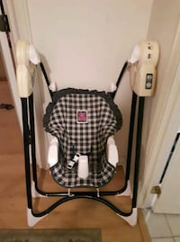 baby's white and black swing chair