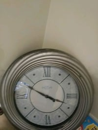 round white analog wall clock St. Catharines