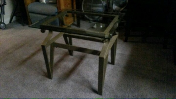 brown wooden framed glass top coffee table
