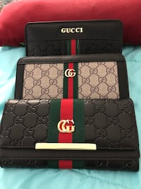 Black and gray gucci leather wallet 544 km