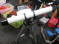 white and black telescope with tripod