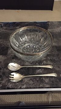Beautiful silver plated and glass salad bowl with spoon and fork utensils