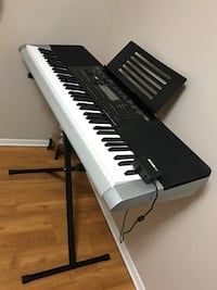 black and white electronic keyboard with stand Toronto, M5V 2T6