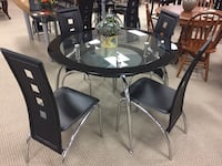 round black metal framed glass top table with chairs Houston, 77077