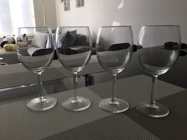 Four clear glass wine glasses