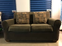 Dark Green Loveseat with Throw Pillows Manassas