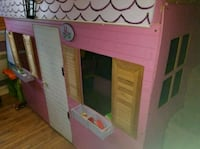 brown and pink wooden house toy Montréal, H1G 2H4