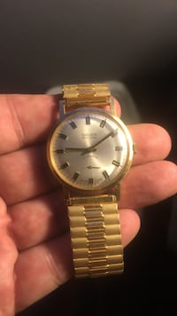 gold link analog watch