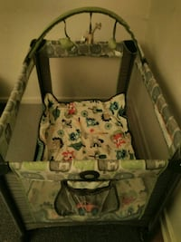 baby's gray and green travel cot 285 mi