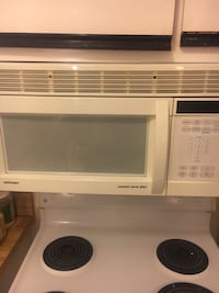 white General Electric microwave oven WASHINGTON
