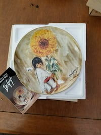 paining of a child holding yellow flower ceramic decorative plate Red Deer, T4R 0B2