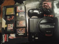 black Nintendo 64 console with controller and game cartridges 367 mi