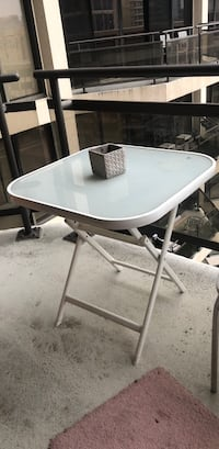 white and gray metal framed glass top patio table 24 mi