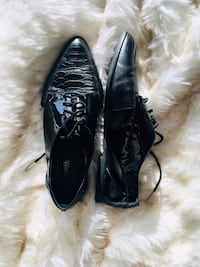 pair of black leather dress shoes Montréal, H1L 5R3