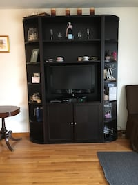 Black wooden tv hutch with flat screen television Methuen, 01844